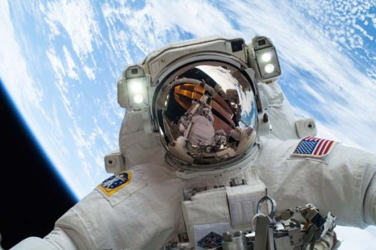 Selfie by Mike Hopkins during a spacewalk on Christmas Eve, 2013