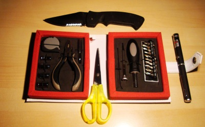 Army knife, tool kit, laser pointer, scissors.
